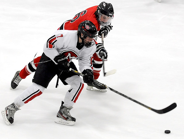 Mankato West's Derek Frentz is pursued by Rochester John Marshall's Alex Lovett during the first period Thursday at All Seasons Arena.