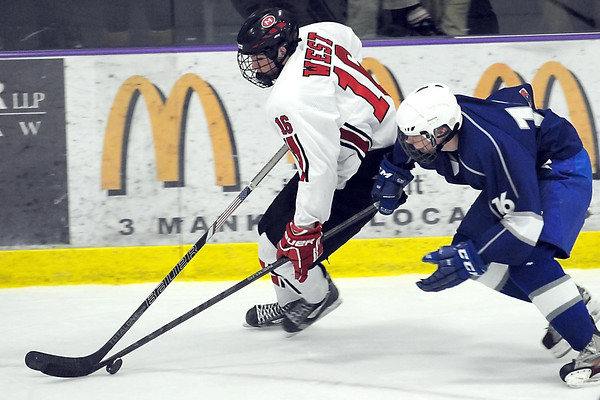 Pat Christman<br /> Mankato West's Cole Filler is chased by Owatonna's Kade Friedrichs during the second period Saturday at All Seasons Arena.