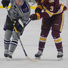 Minnesota State's Parker Tuomie (left) chases after a dump in against University of Minnesota-Duluth's Mikey Anderson in the first period of play during Tuesday's game played at the Verizon Center. Toumie scored for the Mavericks in the second period in a tightly defended game. Photo by Jackson Forderer