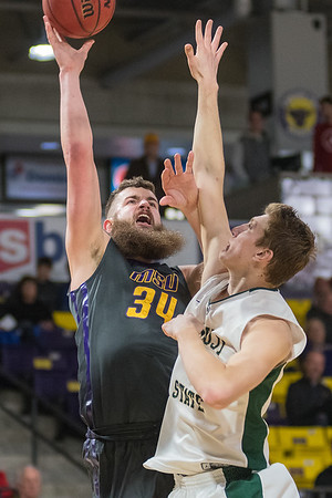 Isaac Kreuer of Minnesota State puts up a shot over Bemidji State's Derek Thompson in the first half of Saturday's NSIC conference game played at Bresnan Arena. Photo by Jackson Forderer