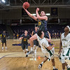 Minnesota State's Kevin Kreiger (25) knocks over Bemidji State's Christian Pekarek in the first half of Saturday's NSIC conference game played at Bresnan Arena. Kreiger scored 30 for the Mavericks and also had a double-double. Photo by Jackson Forderer