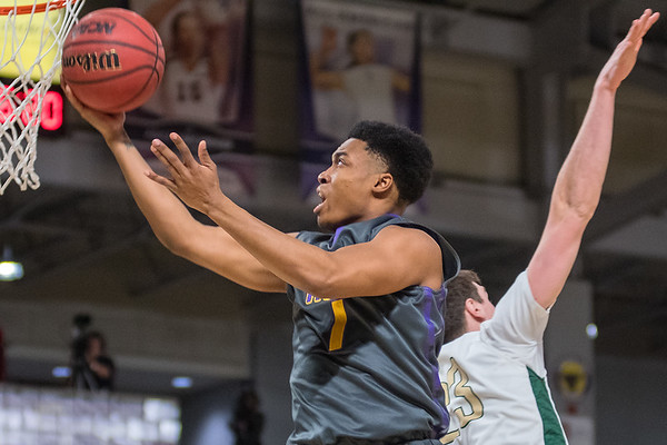 Minnesota State's Jamal flies past Bemidji State's Zach Baumgartner in the first half of Saturday's game played at Bresnan Arena. Photo by Jackson Forderer
