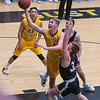Gustavus' Marten Morem goes up for a layup over St. Olaf's Troy Diggins Jr. in the second half of Wednesday's MIAC conference game played at Gustavus. The Gusties won the game 82-70. Photo by Jackson Forderer