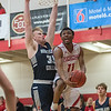 Bethany Lutheran's Cire Mayfield goes in for a reverse layup while being defended by Northland College's Gus Farrell in the second half of Saturday's game. Photo by Jackson Forderer