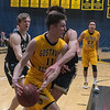 Gustavus' CJ Woda is fouled by St. Olaf's Niko Polydorou as he tries to get into the lane during Wednesday's game. Photo by Jackson Forderer