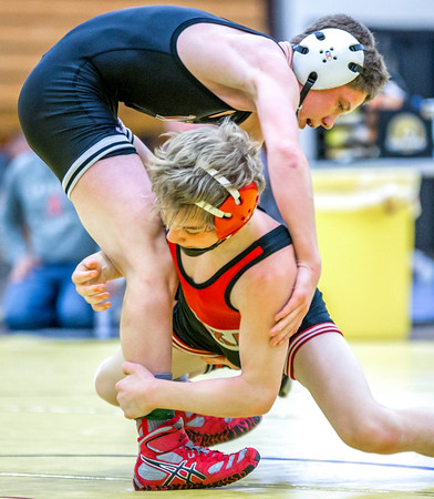 West's Charlie Pickell (left) goes for the back of Watertown-Mayer's Lukas Gilbert (right) during the Cougar invite at East on Saturday. Photo by Trevor Cokley