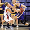 Minnesota State University Moorhead's Marisa Yternatich and Minnesota State's Lexie Ulfers battle for a rebound during the first half Saturday at Bresnan Arena.