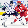 Wisconsin's Ryan Little defends Minnesota State's Matt Leitner during the first period Friday at the Verizon Wireless Center.