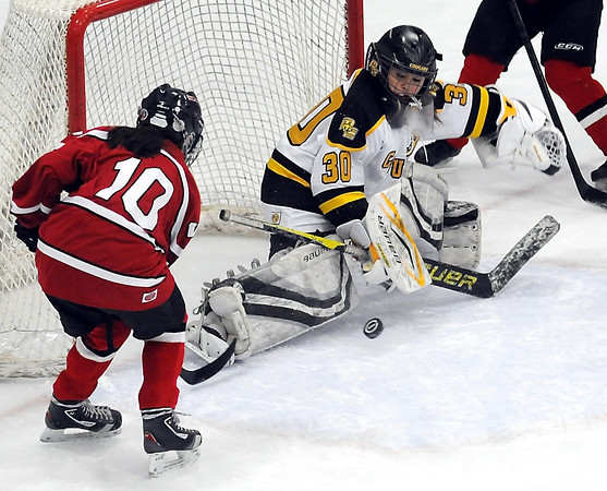 Mankato East/Loyola goalie Katie Paulson makes a stop on a shot by Mankato West's Mackenzie Hays during the first period Thursday at All Seasons Arena.