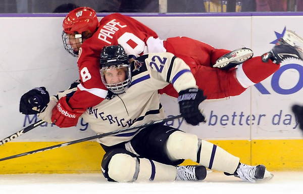 Wisconsin's Matt Paape sails over Minnesota State's Johnny McInnis after they collide along the boards during the first period Saturday at the Verizon Wireless Center.