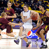 Minnesota State's Zach Monaghan drives through a trio of Northern State defenders on the way to the hoop during the second half Friday at Bresnan Arena.