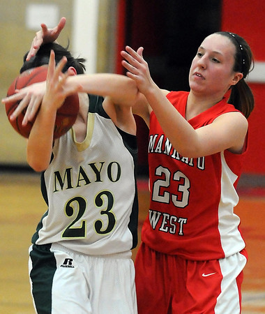 Pat Christman<br /> Rochester Mayo's Olivia Korngable steals the ball from Mankato West's Sara Buryska during the second half Friday at the West gym.