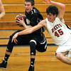 Pat Christman<br /> Mankato East's Nic Seiler keeps the ball away from Rochester John Marshall's Brady Tuckner during the first half Friday.