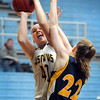 Pat Christman<br /> Gustavus Adolphus College's Anna Lundquist goes up for a shot against Carleton's Anna Surrey during the first half Saturday in St. Peter.