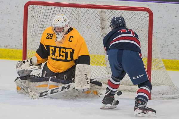 Cole Wentzel of Albert Lea slips a rebound past Mankato East goalie Jack Cusey (29) in the first period of Tuesday's Big Nine conference game played at All Seasons Arena. Photo by Jackson Forderer