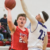 Mankato West's Zach Franke puts up a shot over Red Wing's Tre Moore during Friday's Big 9 Conference game played at West. Photo by Jackson Forderer