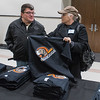 Vickie Conlon (right) and Mike Conlon discuss whether or not to buy a t-shirt with the new MoonDogs logo on it. The new logo was revealed by the team at the Verizon Center on Thursday. Photo by Jackson Forderer