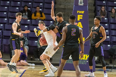 Minnesota State's Cameron Kirksey takes an unexpected piggy back ride on Southwest Minnesota State's Braedan Hanson's back after Hanson got Kirksey airborne with a shot fake. Photo by Jackson Forderer