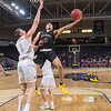 Minnesota State's Juwan McCloud (0) lays the basketball up past Southwest Minnesota State's Braedan Hanson (1) in the first half of Saturday's game played at Bresnan Arena. The Mavericks defeated the Mustangs 101-72 to improve to 12-4. Photo by Jackson Forderer