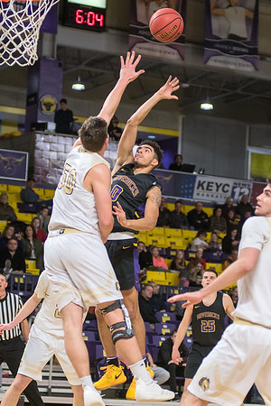 Minnesota State's Juwan McCloud (right) puts up a floater over the outstretched arm of Southwest Minnesota State's Kolin Bartlett during Saturday's game played at Bresnan Arena. Photo by Jackson Forderer