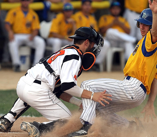 Mankato MoonDogs catcher Chase Fowler keeps Waterloo's Peter Leonello from scoring during the first inning Tuesday at Franklin Rogers Park.