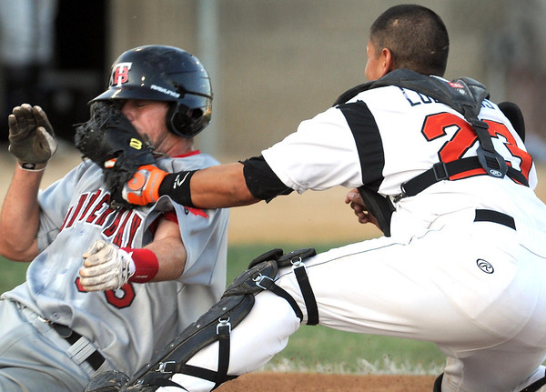 Mankato MoonDogs catcher Zach Luevanos puts the tag on the face of Thunder Bay's Danny Bethea at the plate during the second inning Friday at Franklin Rogers Park.