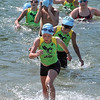 Swimmers in the 9 to 13 age group emerge from Hiniker Pond during the North Mankato Kids Triathlon Saturday.
