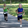 Runners in the under 6 age group charge toward the finish line during the North Mankato Kids Triathlon Saturday.