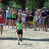 A runner is cheered to the finish line during Saturday's North Mankato Kids Triathlon.
