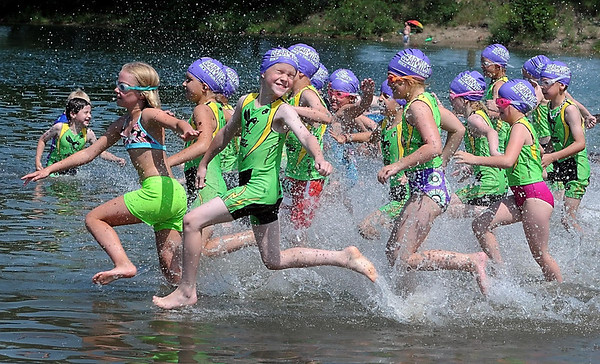 Kids in the 7 to 8 age range hit the water during the North Mankato Kids Triathlon Saturday at Hiniker Pond.