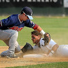 John Cross<br /> Moondog runner Habraim Cordova slids safely under the tag of Rox shortstop Brad Strong for a double in third inning action at Franklin Rogers Park on Saturday.