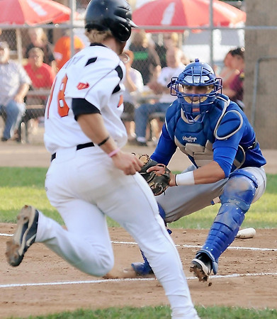 John Cross<br /> Bucks catcher Kyle Pollock prepares to put the tag on Moondogs runner Chase Simpson who was attempting to score from 2nd base during first inning action.