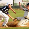 John Cross<br /> Twins shortstop puts the tag on Austin's Steve Serratore during an attempted steal Thursday at Franklin Rogers Park.