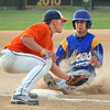 Owatonna's Derick Ritter slides in under the tag of Mankato Mets' Sam Stier during the fourth inning Friday at Wolverton Field.