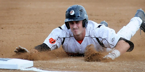 John Cross<br /> Moondogs Zack Zehner stretches an early inning double to third base after a Stingers outfielder mishandled the ball.