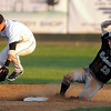 Honkers' base runner Alex Tenorio is safe at second after Moondogs second baseman Woody Woodward loses the handle on a throw from the shortstop during fifth inning action.