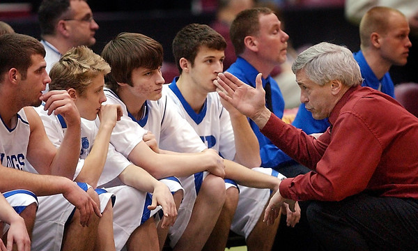 John Cross<br /> JWP head coach Ted Hammond talks to his bench late in the game against Minnesota Transition Charter. JWP lost their opening round game Thursday in the boys state basketball tournament, 74-32.