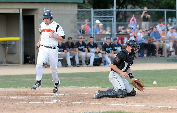 The MoonDogs' Derek Umphres scores ahead of the throw to Rochester catcher Jack Goihl during the fourth inning Wednesday at Franklin Rogers Park. Photo by Pat Christman