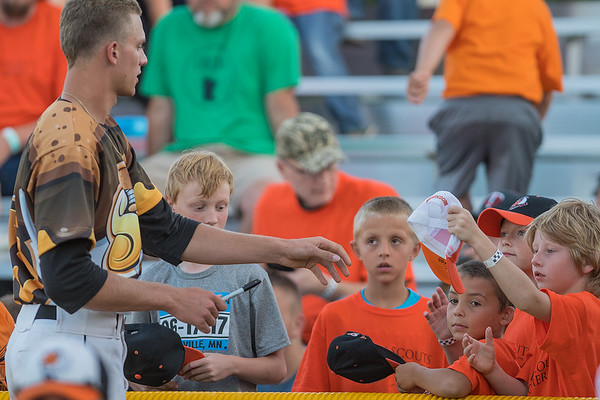 Logan Alleman of the MoonDogs signs autographs for young fans at Franklin Rogers Park on Friday. Photo by Jackson Forderer