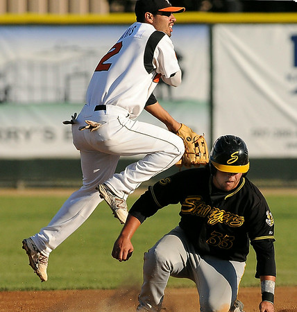 Stingers' Nick Rivera is out at second but airvborne Moondogs' shortstop Peter Maris can't quite turn the double play in action at Franklin Rogers Park on Thursday.