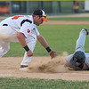 Mankato MoonDogs first baseman Toby Hanson (left) comes up short of tagging out Gabriel Lozada of Thunder Bay during a pick off attempt in Thursday's game. Photo by Jackson Forderer