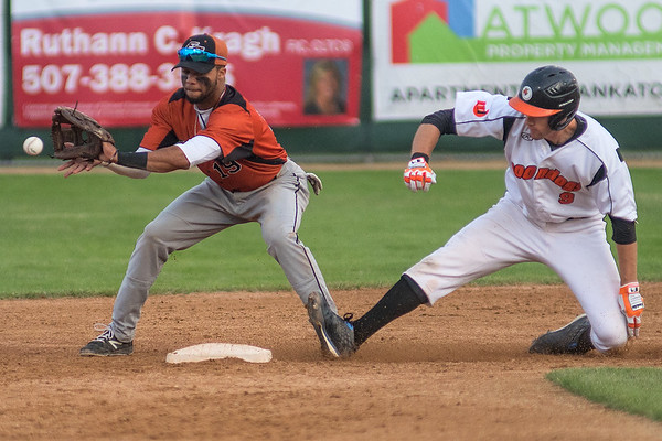 Ryan Kreidler (9) of the Mankato MoonDogs slides safely into second base ahead of a throw caught at second base by Luke Bandy (19) of the Eau Claire Express. Photo by Jackson Forderer