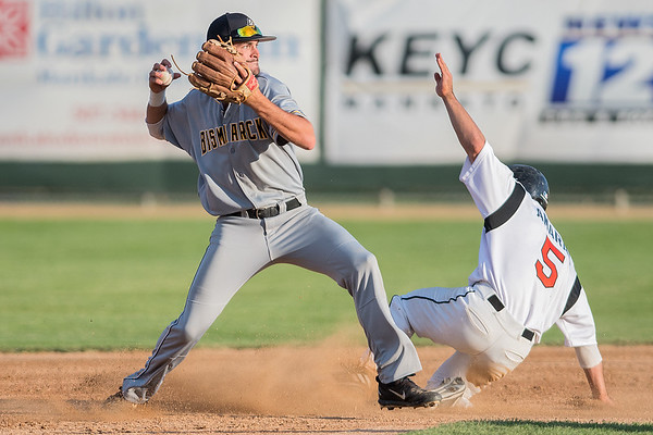 Mankato MoonDogs Daniel Amaral's take out slide prevents Mitch Gallagher of the Bismarck Larks from making a throw to first base for a double play in Saturday's game. Photo by Jackson Forderer