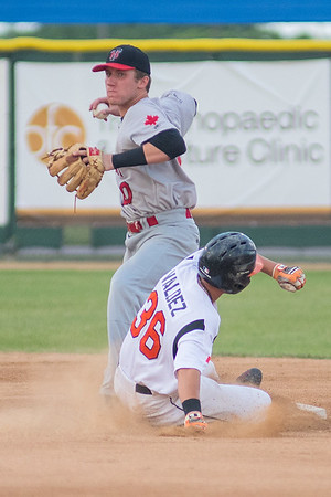 Andy Weber of the Thunder Bay Border Cats completes a double play with a throw to first despite Ethan Valdez's attempt to break up the play during Thursday's game. Photo by Jackson Forderer