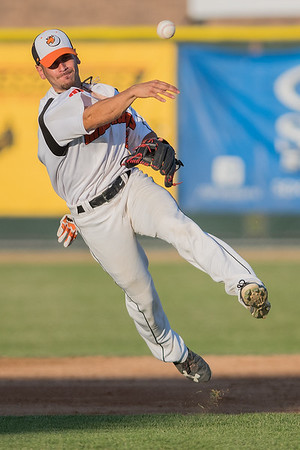 MoonDogs shortstop Alvaro Rubalcaba makes a throw to first after fielding a ground ball in Saturday's game played against Bismarck. Photo by Jackson Forderer