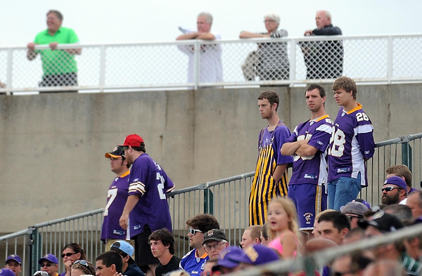 Pat Christman <br /> Fans watch Tuesday's practice from the stands near the practice field and from atop Blakeslee Stadium.