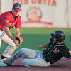 Mankato American's Jake Prybylla steps on second base just in time to force out Worthington's Mason Ellenbecker during Wednesday's first round in the Sub-state District baseball tournament played at Franklin Rogers Park. Photo by Jackson Forderer