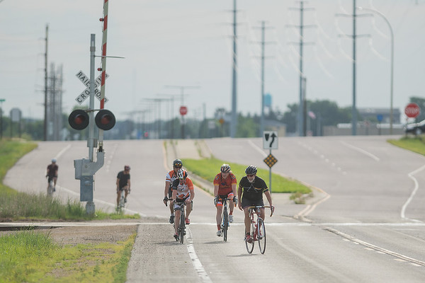 A group of bike riders crosses the railroad tracks along Victory Drive west of Mankato. The small group begins their ride each week at Flying Penguin Outdoor Sports on Wednesdays. Photo by Jackson Forderer