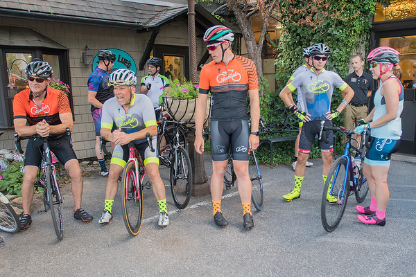 Bike riders wait to begin their weekly group ride outside of Nicollet Bike Shop on Tuesday. The group splits up into three groups based on their level of experience. Photo by Jackson Forderer