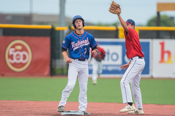 Tom Yokiel (left) shows his disappointment after being called out on a steal attempt of second base while Jake Prybylla of the Mankato American baseball team shows the umpire the ball still in his glove. Yokiel's disappointment was temporary however, as the Nationals won the game 6-4 to advance in the Sub-state 2 playoffs. Photo by Jackson Forderer